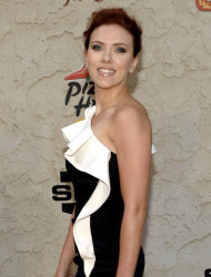 "FILE - In this June 4, 2011 file photo, actress Scarlett Johansson arrives at the Spike TV Guys Choice Awards in Culver City, Calif. Johansson and singer Christina Aguilera are among the many celebrities whose racy ""private"" photos have been hacked and posted to the Internet. (AP Photo/Dan Steinberg, file)"
