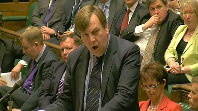 "In this image taken from TV,  Britain's Culture, Media and Sport secretary John Whittingdale speaks in the House of Commons, in London Thursday May 28, 2015.  Whittingdale said ""change in the leadership of FIFA is very badly needed,"" and that  major sponsors should follow Visa and review their links with FIFA in the wake of corruption charges against senior FIFA officials. (PA via AP) UNITED KINGDOM OUT"