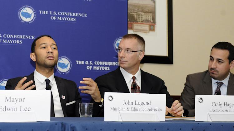 From left to right, musician John Legend; Craig Hagen, Senior Director of Government Affairs at Electronic Arts, Inc.; and Roberto Rodriguez, Special Assistant to the President for Education Policy; speak during a panel on STEM education and the announcement of SimCity EDU by EA Maxis at the National Conference of Mayors, Friday, Jan. 18, 2013, in Washington. (Photo/Nick Wass/Invision for EA)