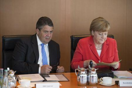 German Chancellor Merkel and Economy Minister Gabriel attend the weekly cabinet meeting in Berlin