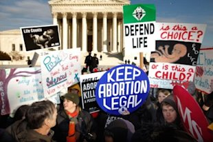 Pro-life and pro-choice demonstrators argue in front of the Supreme Court during the March for Life in Washington, D.C., on January 24, 2011. Photo by Chip Somodevilla, Getty Images