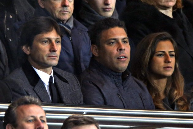 Paris St Germain sports director Leonardo and Former Brazilian striker Ronaldo attend a soccer match between Paris Saint-Germain and Olympic Marseille in Paris