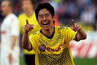 Japan midfielder Shinji Kagawa, pictured in March 2012, has joined Manchester United on a four-year deal from German champions Borussia Dortmund, the Premier League side announced Friday