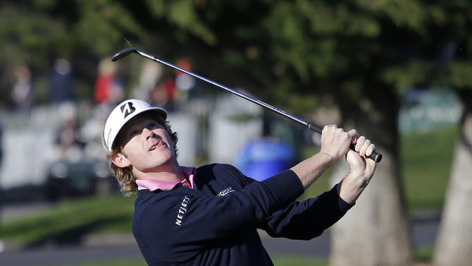 Brandt Snedeker chips the ball to the second green of the Pebble Beach Golf Links during the third round of the AT&T Pebble Beach Pro-Am golf tournament  Saturday, Feb. 9, 2013, in Pebble Beach, Calif. Snedeker shot a 4-under-par 68, and is at 12 under for the tournament. (AP Photo/Eric Risberg)