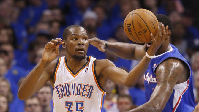 Oklahoma City Thunder forward Kevin Durant (35) reaches for the ball in the first quarter of Game 2 of the Western Conference semifinal NBA basketball playoff series against the Los Angeles Clippers in Oklahoma City, Wednesday, May 7, 2014. (AP Photo/Sue Ogrocki)