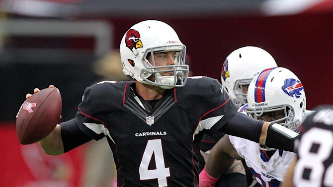 Arizona Cardinals quarterback Kevin Kolb (4) looks to throw against the Buffalo Bills during the first half of an NFL football game on Sunday, Oct. 14, 2012, in Glendale, Ariz.  (AP Photo/Paul Connors)