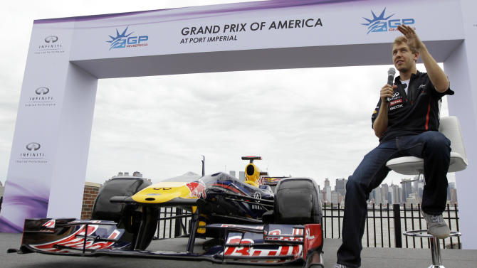 Defending Formula One champion Sebastian Vettel, of Germany,  talks about the steep hills in Weehawken, N.J., Monday, June 11, 2012. Vettel drove a 3.2-mile course to demonstrate the planned route for next year's Grand Prix of America race.  (AP Photo/Julio Cortez)