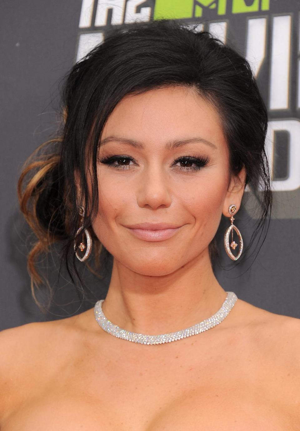"Jenni ""Jwoww"" Farley arrives at the MTV Movie Awards in Sony Pictures Studio Lot in Culver City, Calif., on Sunday April 14, 2013. (Photo by Jordan Strauss/Invision/AP)"