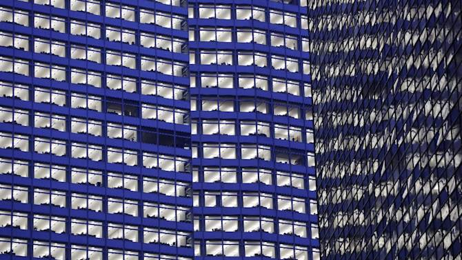 FILE - In this Tuesday, Jan. 15, 2013, file photo, lights are on at Goldman Sachs's headquarters, in New York. The FDIC issues the U.S. banking industry's financial results for the January-March quarter, on Wednesday, May 29, 2013. (AP Photo/Mark Lennihan, File)