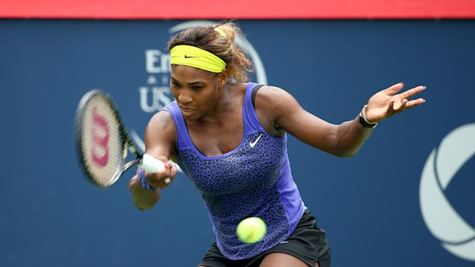 Serena Williams serves to Caroline Wozniacki during their Rogers Cup clash in Montreal, Canada on August 8, 2014