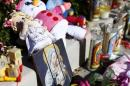 n impromptu memorial grows along a sidewalk next to a laneway where the body of 3-week-old Eliza Delacruz was found dead inside a dumpster in Imperial Beach, California