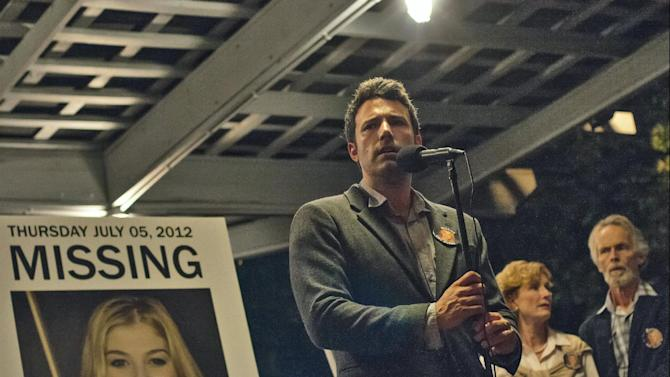 """This image released by 20th Century Fox shows Ben Affleck in a scene from """"Gone Girl."""" The film will make its world premiere as the opening night film at the 52nd New York Film Festival. The Film Society of Lincoln Center announced Thursday, July 17, 2014, that the highly anticipated adaption of Gillian Flynn's best-selling novel will kick off the festival on September 26. The 20th Century Fox thriller, which stars Ben Affleck and Rosamund Pike, will premiere in theaters shortly after on October 3. (AP Photo/20th Century Fox, Merrick Morton)"""