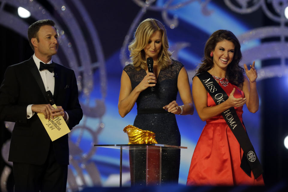 Miss Oklahoma Kelsey Griswold, right, reacts before answering a question during the Miss America 2014 pageant, Sunday, Sept. 15, 2013, in Atlantic City, N.J. (AP Photo/Mel Evans)
