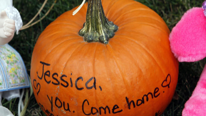 "A pumpkin with an inscription ""Love You, Come home"" sits with stuffed animals at a park near the home of the missing 10-year-old  Jessica Ridgeway in Westminster, Colo., on Friday, Oct. 12, 2012. Police discovered a body in a field six miles away but have yet to identify the remains.  Jessica Ridgeway went missing on Friday, Oct. 5 after she left her home on her way to school.  (AP Photo/Ed Andrieski)"