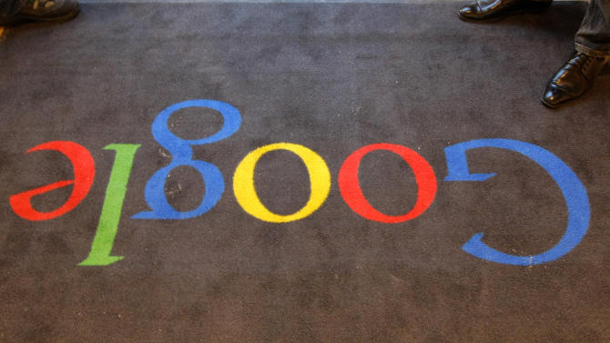 """FILE - In this Dec.6, 2011 file photo, the Google logo is seen on the carpet at Google France offices before its inauguration, in Paris. Publishers in France, Germany and Italy want their governments to impose a """"news tax"""" on Google to save them from extinction, demanding a law that would charge the search engine small payments in exchange for links to stories. Google, in response, says it will cease to index the sites altogether, warning that the proposals do nothing to solve the industry's problems on the continent that invented the printing press. (AP Photo/Jacques Brinon, Pool, File)"""