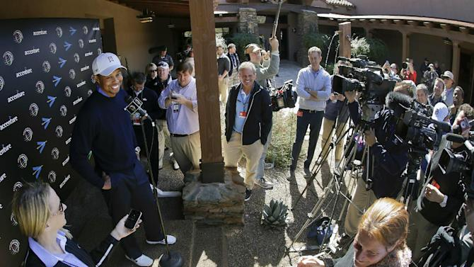 Tiger Woods answers questions during a news conference before playing a practice round for the Match Play Championship golf tournament, Tuesday, Feb. 19, 2013, in Marana, Ariz. (AP Photo/Julie Jacobson)