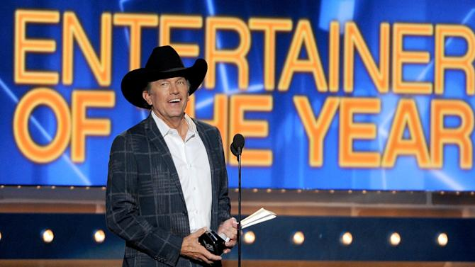 George Strait accepts the award for entertainer of the year at the 49th annual Academy of Country Music Awards at the MGM Grand Garden Arena on Sunday, April 6, 2014, in Las Vegas. (Photo by Chris Pizzello/Invision/AP)