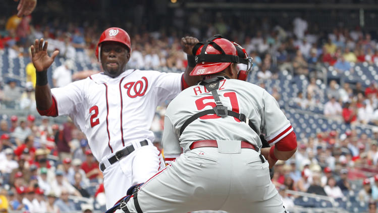 Washington Nationals' Roger Bernadina, left, slides into home plate to score as Philadelphia Phillies catcher Carlos Ruiz waits for the throw during the first inning of a baseball game at Nationals Park in Washington, Wednesday, June 1, 2011. Bernadina scored from second on an RBI single by Jayson Werth.   (AP Photo/Manuel Balce Ceneta)