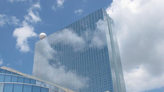 Clouds are reflected in the facade of Revel, Atlantic City's newest casino, in this May 10, 2012 photo. Revel's monthly revenue declined in September for the first time in its six-month history, falling from $20 million in August to $16.8 million in September. (AP Photo/Wayne Parry)