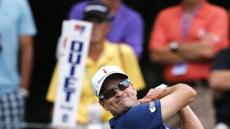 Zach Johnson watches his drive off the 18th tee during the second round of the 2014 John Deere Classic golf tournament at TPC Deere Run in Silvis, Ill., Friday, July 11, 2014. (AP Photo/Charles Rex Arbogast)