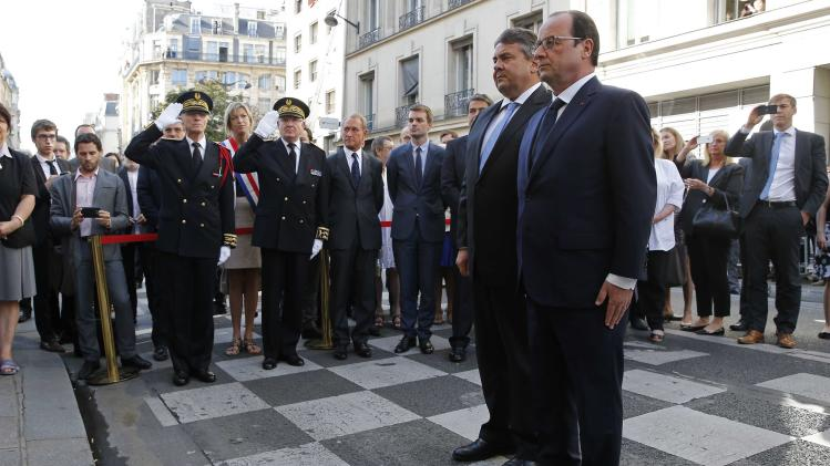 French President Hollande and German Minister for Economic Affairs and Energy Gabriel attend a ceremony in front 'La Taverne du Croissant' Cafe in Paris for the 100th anniversary of the assassination of the Socialist leader Jaures