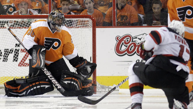 Philadelphia Flyers goalie Ilya Bryzgalov, left, of Russia, blocks a shot by a countryman, New Jersey Devils' Ilya Kovalchuk, during the second period of Game 5 of a second-round NHL hockey Stanley Cup playoff series, Tuesday, May 8, 2012, in Philadelphia. (AP Photo/Matt Slocum)