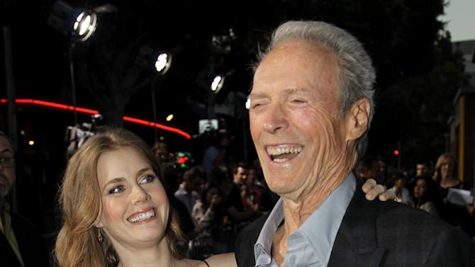 """Cast members Clint Eastwood, right, and Amy Adams pose together at the premiere of """"Trouble With the Curve"""" at the Westwood Village Theater on Wednesday, Sept. 19, 2012, in Los Angeles. (Photo by Matt Sayles/Invision/AP)"""