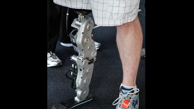 Zac Vawter's stands on his bionic leg after he arriving on the 103rd floor of Willis Tower, becoming the first person ever to complete the task wearing the mind-controlled prosthetic limb, Sunday, Nov. 4, 2012 in Chicago. Vawter, who lost his right leg in a motorcycle accident, put the smart limb on public display for the first time during an annual stair-climbing charity event called ìSkyRise Chicagoî hosted by the Rehabilitation Institute of Chicago, where he is receiving treatment. (AP Photo/Teresa Crawford)
