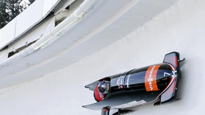 Austria's pilot Christina Hengster with brakewoman Inga Versen race to a fourth-place finish in the women's bobsled World Cup competition on Friday, Nov. 9, 2012, in Lake Placid, N.Y. (AP Photo/Mike Groll)
