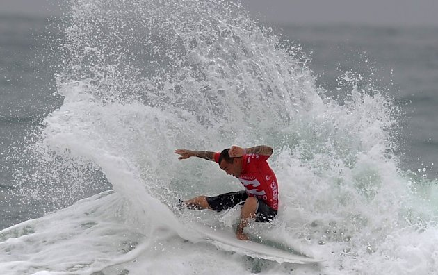 Brazilian surfer Raoni Monteiro competes in the Association of Surfing Professionals' men's 2012 ASP World Championship Tour at Barra da Tijuca beach in Rio de Janeiro, Brazil, on May 14, 2012.  AFP P