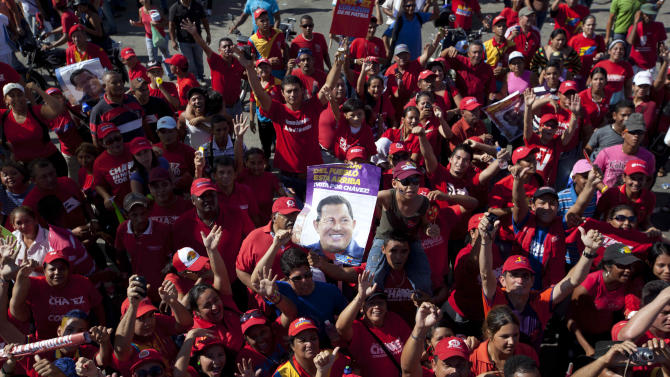 Supporters of Venezuela's President Hugo Chavez  gather during a campaign caravan in Sabaneta, Venezuela, Monday, Oct. 1, 2012. Venezuela's presidential election is scheduled for Oct. 7. (AP Photo/Rodrigo Abd)