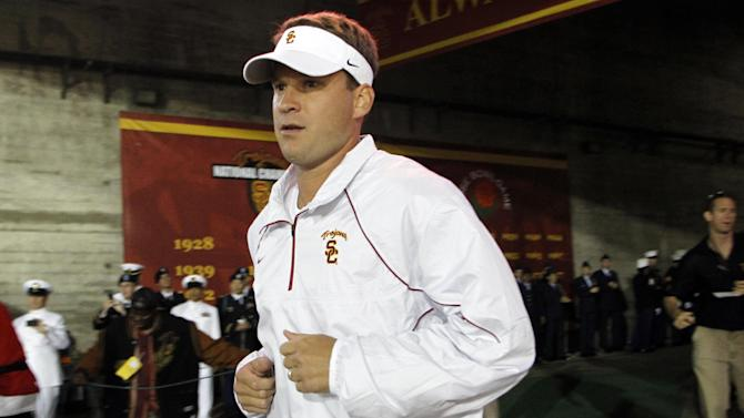 FILE - In this Sept. 11, 2010 file photo, Southern California head coach Lane Kiffin runs out of the tunnel after his team for an NCAA college football game against Virginia in Los Angeles. USC is ranked No. 1 in the Associated Press preseason college football poll released on Saturday, Aug. 18, 2012. (AP Photo/Danny Moloshok, File)