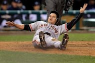 Ryan Theriot of the San Francisco Giants slides to home after a run off of Marco Scutaro of the San Francisco Giants an RBI single to center field against Phil Coke of the Detroit Tigers on October 28, 2012 in Detroit, Michigan