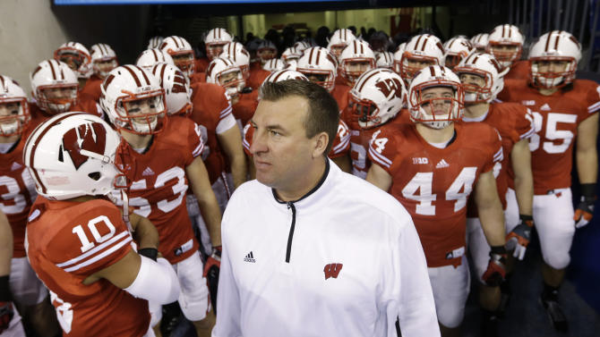 FILE - In this Dec. 1, 2012, file photo, Wisconsin coach Bret Bielema waits to take the field with his team before the Big Ten championship NCAA college football game against Nebraska in Indianapolis. A person familiar with the situation tells The Associated Press on Tuesday, Dec. 4, 2012, that Bielema has agreed to become the new coach at Arkansas. (AP Photo/Darron Cummings, File)