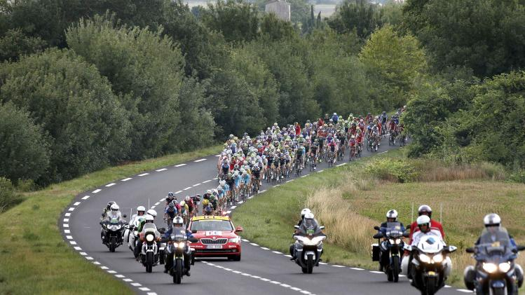 The pack rides along a winding road during the 237.5km16th stage of the Tour de France cycling race
