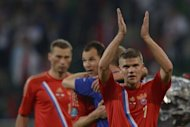 Russian midfielder Igor Denisov (R) celebrates at the end of their Euro 2012 Group A match against Czech Republic, on June 8, at the Municipal stadium in Wroclaw. Russia won 4-1
