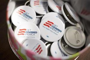 Get Covered America buttons are seen during a training session in Chicago
