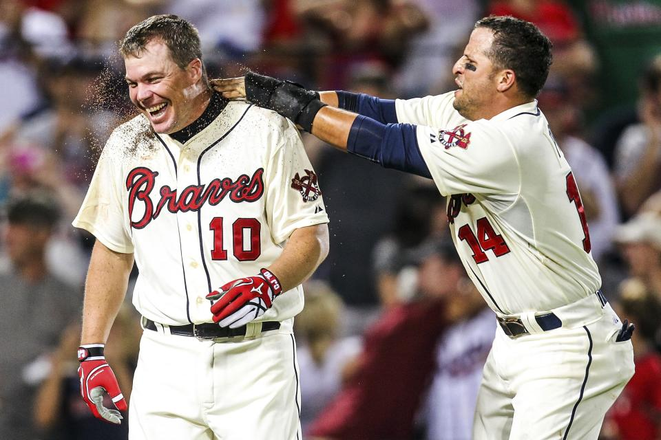 Atlanta Braves' Chipper Jones (10) celebrates his three-run, walk-off home run with Martin Prado (14) after a baseball game against the Philadelphia Phillies, Sunday, Sept. 2, 2012, in Atlanta. The Braves won 8-7. (AP Photo/Daniel Shirey)