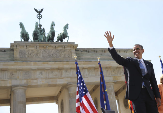 U.S. President Obama waves as he arrives to give a speech in front of the Brandenburg Gate at Pariser Platz in Berlin