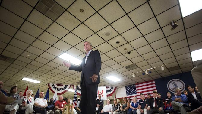 Republican presidential candidate and former Florida Governor Bush gestures while speaking during a town hall event at a VFW hall in Norfolk