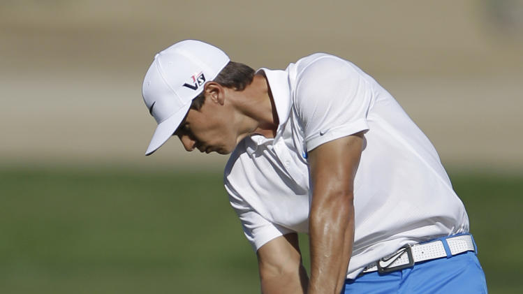Thorbjorn Olesen of Denmark plays a ball on the 10th hole during the third round of Abu Dhabi Golf Championship in Abu Dhabi, United Arab Emirates, Saturday, Jan. 19, 2013. (AP Photo/Kamran Jebreili)