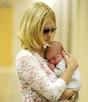 January Jones and her son Xander Jones are seen coming out of an office building in Los Angeles, Calif. on October 11, 2011 -- FilmMagic