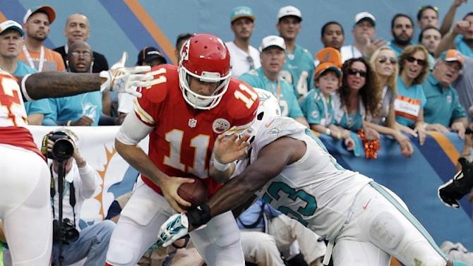 Miami Dolphins linebacker Jelani Jenkins (53) sacks Kansas City Chiefs quarterback Alex Smith (11) in the end zone for a safety during the second half of an NFL football game, Sunday, Sept. 21, 2014, in Miami Gardens, Fla. (AP Photo/Lynne Sladky)