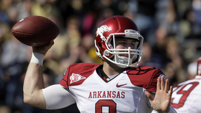 Arkansas quarterback Tyler Wilson (8) passes against Vanderbilt in the second quarter of an NCAA college football game on Saturday, Oct. 29, 2011, in Nashville, Tenn. (AP Photo/Mark Humphrey)