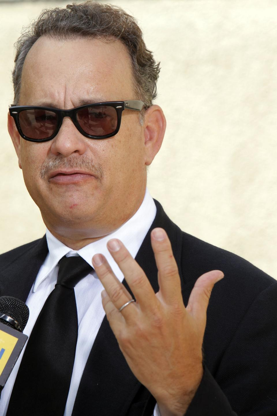 Actor Tom Hanks arrives at the Michael Clarke Duncan Memorial Service at Forest Lawn Memorial-Park and Mortuaries in the Hollywood Hills section of Los Angeles, Monday, September 10,  2012. (AP Photo/Nick Ut)