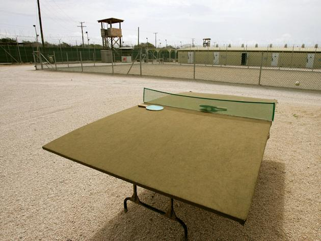 GUANTANAMO BAY, CUBA - AUGUST 23:  A ping pong table for detainees sits in the middlle of a court yard at Camp Delta at Guantanamo Naval Base August 23, 2004 in Guantanamo, Cuba. On August 24, prelimi