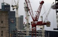 <p>Construction work in the City of London financial district. Britain has slashed its economic outlook , forecasting the economy would shrink by 0.1 percent this year and then return to growth in 2013, according to figures published alongside a budget update.</p>