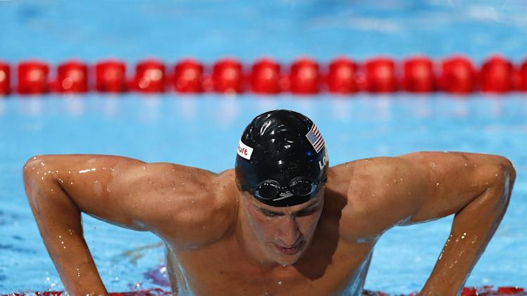 United States's Ryan Lochte exits the pool after winning the gold medal in the Men's 200m backstroke final at the FINA Swimming World Championships in Barcelona, Spain, Friday, Aug. 2, 2013. (AP Photo/Daniel Ochoa de Olza)