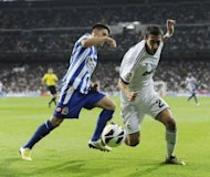 Deportivo forward Pizzi (L) and Real Madrid midfielder Angel di Maria during their Spanish League match on September 30. The visitors had seen little of the ball but went ahead through practically their first attack thanks to a Madrid defence which had gaping holes
