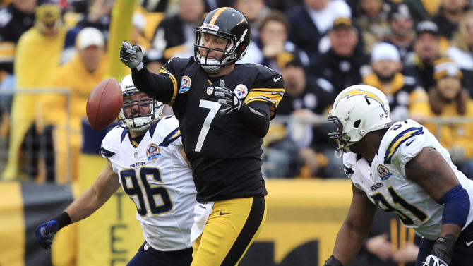 Pittsburgh Steelers quarterback Ben Roethlisberger (7) loses the ball as he passes under pressure by San Diego Chargers outside linebacker Jarret Johnson (96) and defensive end Kendall Reyes (91) in the first quarter of an NFL football game in Pittsburgh, Sunday, Dec. 9, 2012. (AP Photo/Gene J. Puskar)